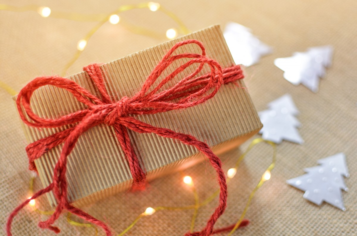 Gift box with a red bow and string lights - Photo credit: CC via pxhere.com